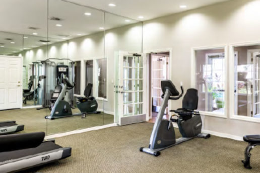 fitness center with mirrored walls